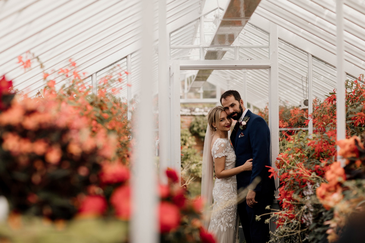 Bride and Groom in one of the Victorian Glasshouses at West Dean Gardens. Credit Esme Ducker Photography