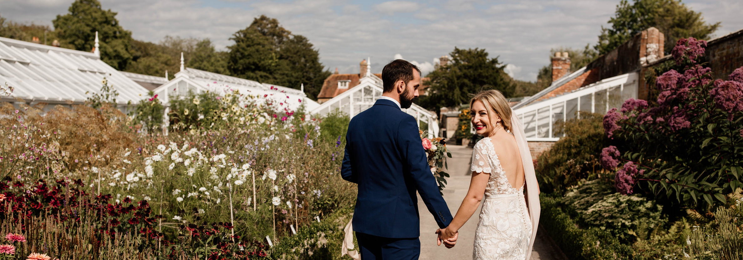 Bride and Groom in the Walled Garden at West Dean Gardens. Credit Esme Ducker Photography