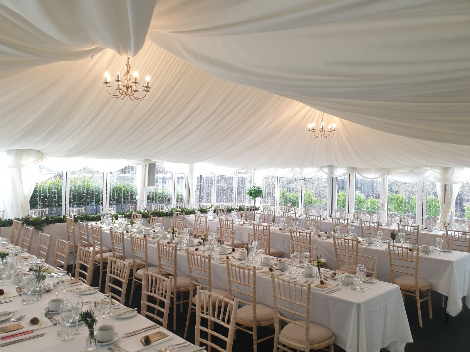 Wedding set up in marquee with long tables