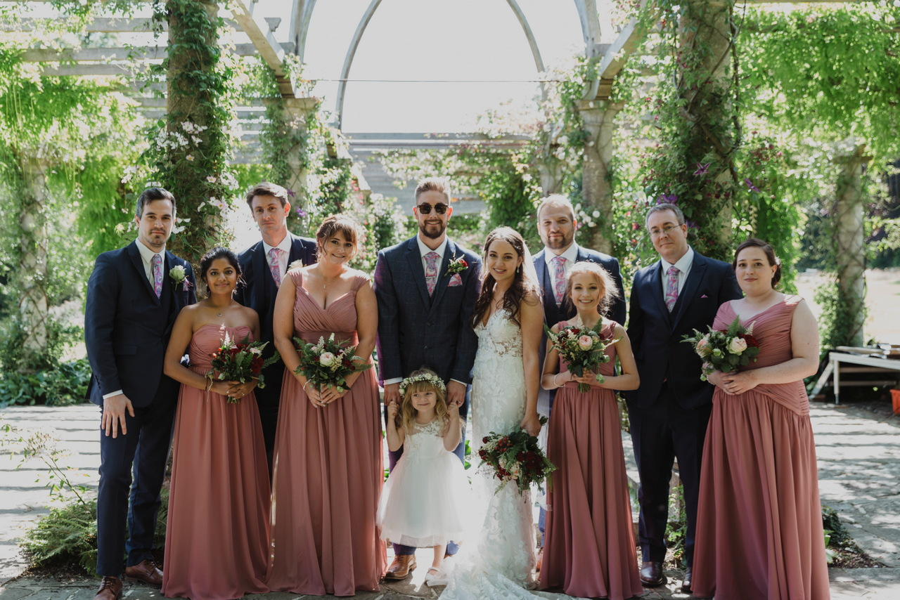 Wedding party with the Edwardian Pergola at West Dean Gardens. Credit Sandshine Photography
