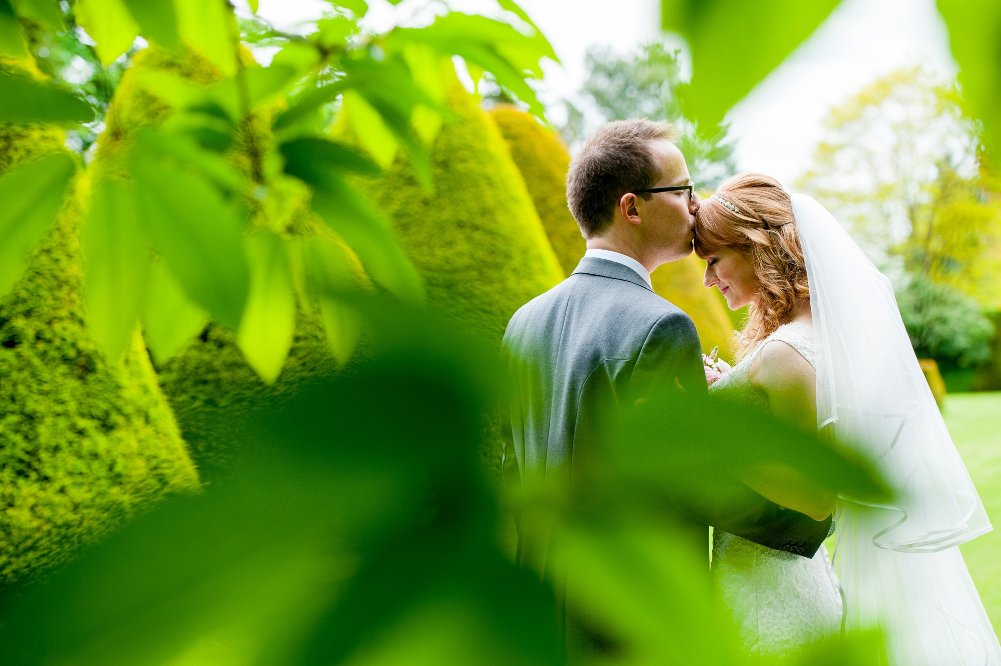 Wedding couple in the East Garden at Holme Pierrepont Hall