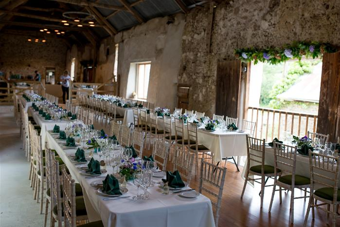 Trestle tables are a great way to seat your guests with space for up to 144 for a seated meal up to a maximum capacity of 200 people.  Credit : Evolve Photography